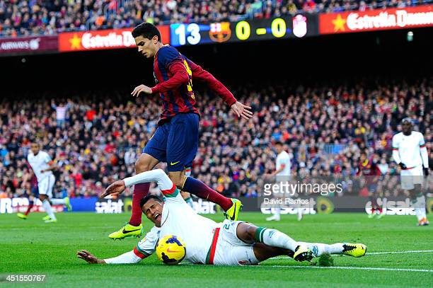 Marc Bartra of FC Barcelona fights for the ball Murillo of Granada CF with the La Liga match between FC Barcelona and Granda CF at Camp Nou on...