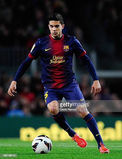Marc Bartra of FC Barcelona runs with the ball during the La Liga match between FC Barcelona and RCD Mallorca at Camp Nou on April 6 2013 in...