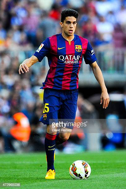 Marc Bartra of FC Barcelona runs with the ball during the La Liga match between FC Barcelona and Real Sociedad de Futbol at Camp Nou on May 9 2015 in...