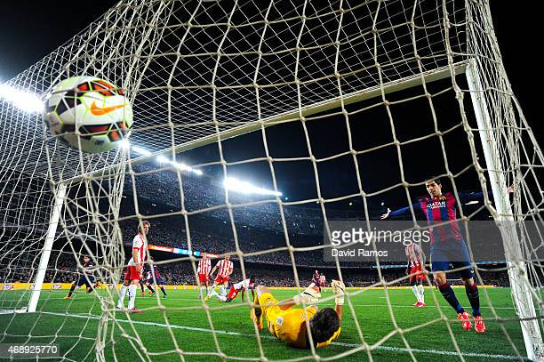 Marc Bartra of FC Barcelona scores his team's third goal during the La Liga match between FC Barcelona and UD Almeria at Camp Nou on April 8 2015 in...