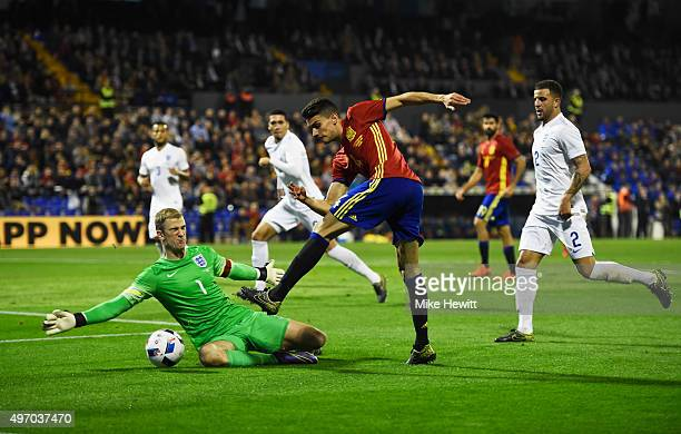 Marc Bartra of Spain is foiled by Joe Hart of England during the international friendly match between Spain and England at Jose Rico Perez Stadium on...