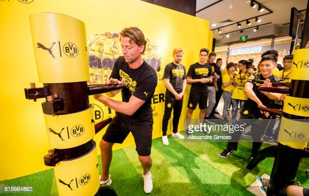 Marc Bartra Roman Weidenfeller and Marcel Schmelzer of Borussia Dortmund at the PUMA activity event in the Puma store Guangzhou during the Borussia...