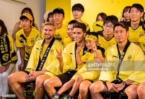 Marc Bartra Shinji Kagawa and Marcel Schmelzer of Borussia Dortmund together with their fans during the KAMO activity event at the PUMA Brand Center...
