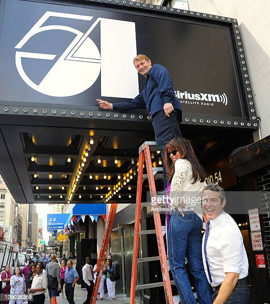 Marc Benecke Myra Scheer and Andy Cohen attend the unveiling of the Marquee at Studio 54 on October 11 2011 in New York City
