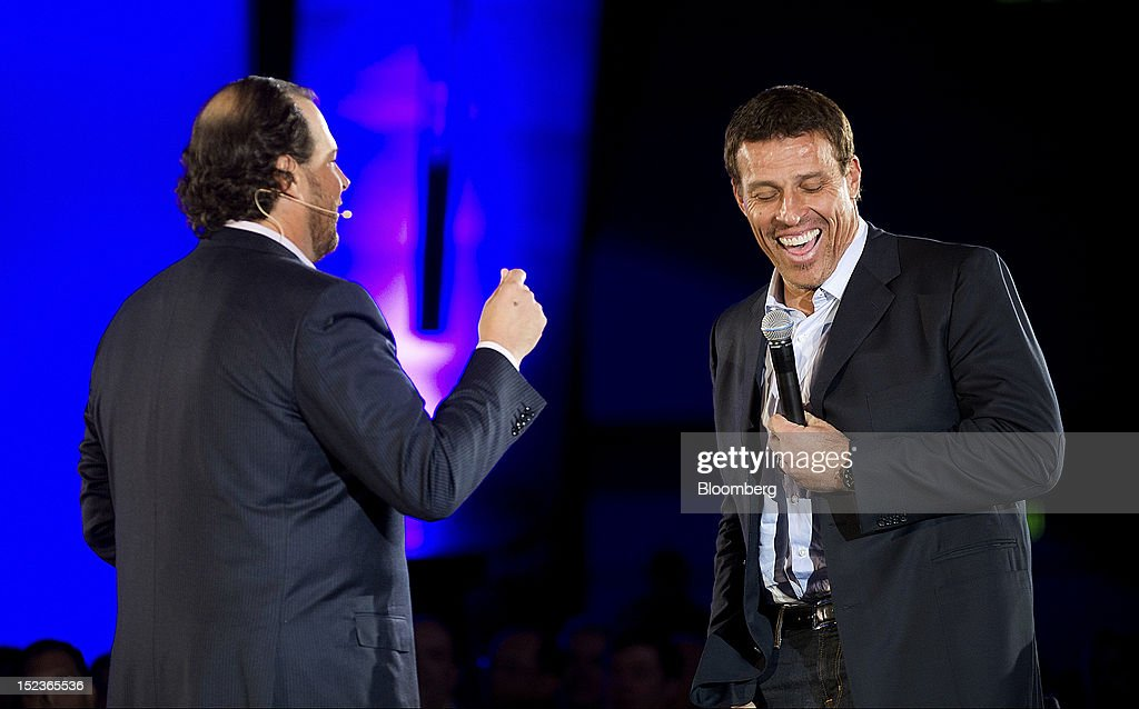 Marc Benioff, chairman and chief executive officer of Salesforce.com Inc., left, speaks with motivational speaker Tony Robbins during a keynote address at the DreamForce Conference in San Francisco, California, U.S., on Wednesday, Sept. 19, 2012. Salesforce.com Inc. said it's releasing a new version of its software for tablet computers and unifying its social-media marketing products into a single suite, as it races to stay ahead of new market entrants. Photographer: David Paul Morris/Bloomberg via Getty Images