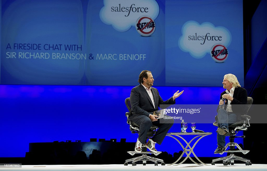 Marc Benioff, chairman and chief executive officer of Salesforce.com Inc., left, speaks with <a gi-track='captionPersonalityLinkClicked' href=/galleries/search?phrase=Richard+Branson&family=editorial&specificpeople=220198 ng-click='$event.stopPropagation()'>Richard Branson</a>, chairman and founder of Virgin Group Ltd., during a keynote address at the DreamForce Conference in San Francisco, California, U.S., on Wednesday, Sept. 19, 2012. Salesforce.com Inc. said it's releasing a new version of its software for tablet computers and unifying its social-media marketing products into a single suite, as it races to stay ahead of new market entrants. Photographer: David Paul Morris/Bloomberg via Getty Images