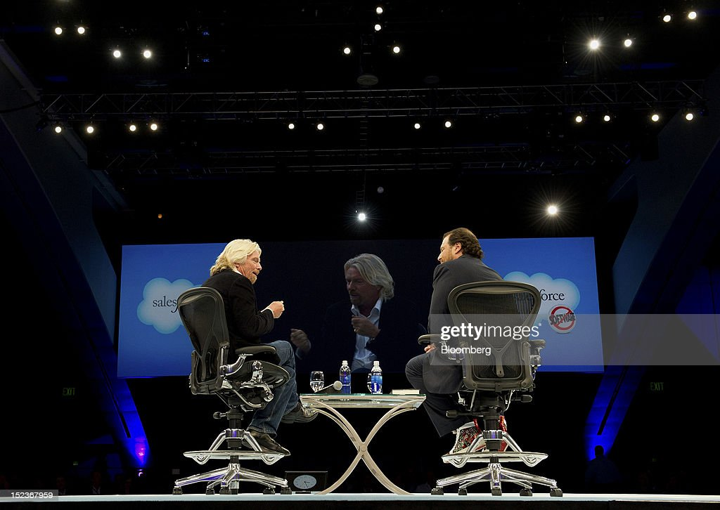 Marc Benioff, chairman and chief executive officer of Salesforce.com Inc., right, speaks with Richard Branson, chairman and founder of Virgin Group Ltd., during a keynote address at the DreamForce Conference in San Francisco, California, U.S., on Wednesday, Sept. 19, 2012. Salesforce.com Inc. said it's releasing a new version of its software for tablet computers and unifying its social-media marketing products into a single suite, as it races to stay ahead of new market entrants. Photographer: David Paul Morris/Bloomberg via Getty Images