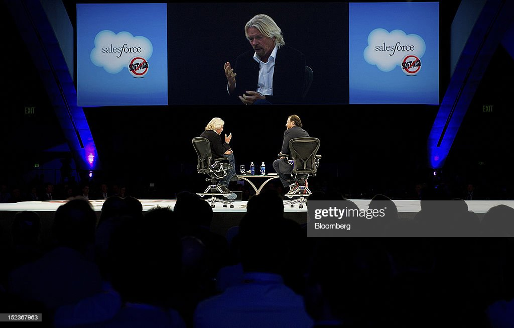 Marc Benioff, chairman and chief executive officer of Salesforce.com Inc., right, speaks with <a gi-track='captionPersonalityLinkClicked' href=/galleries/search?phrase=Richard+Branson&family=editorial&specificpeople=220198 ng-click='$event.stopPropagation()'>Richard Branson</a>, chairman and founder of Virgin Group Ltd., during a keynote address at the DreamForce Conference in San Francisco, California, U.S., on Wednesday, Sept. 19, 2012. Salesforce.com Inc. said it's releasing a new version of its software for tablet computers and unifying its social-media marketing products into a single suite, as it races to stay ahead of new market entrants. Photographer: David Paul Morris/Bloomberg via Getty Images