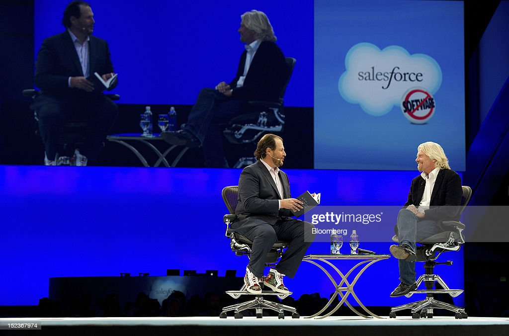 Marc Benioff, chairman and chief executive officer of Salesforce.com Inc., left, speaks with Richard Branson, chairman and founder of Virgin Group Ltd., during a keynote address at the DreamForce Conference in San Francisco, California, U.S., on Wednesday, Sept. 19, 2012. Salesforce.com Inc. said it's releasing a new version of its software for tablet computers and unifying its social-media marketing products into a single suite, as it races to stay ahead of new market entrants. Photographer: David Paul Morris/Bloomberg via Getty Images