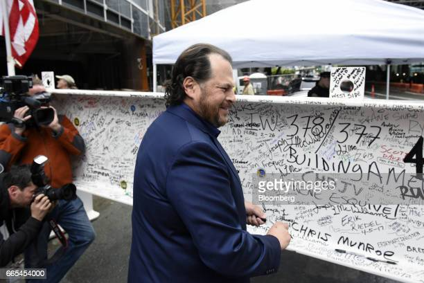 Marc Benioff chairman and chief executive officer of Salesforcecom Inc signs the final steel beam during a topping off ceremony for the Salesforce...