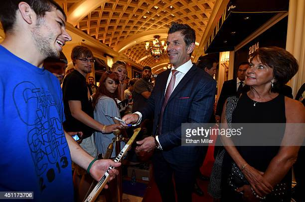 Marc Bergevin General Manager of the Montreal Canadiens and his sister Carol Bergevin arrive on the red carpet prior to the 2014 NHL Awards at Encore...