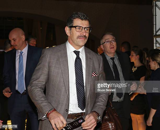 Marc Bergevin of the Montreal Canadians walks the red carpet prior to the induction ceremony at the Hockey Hall of Fame on November 17 2014 in...