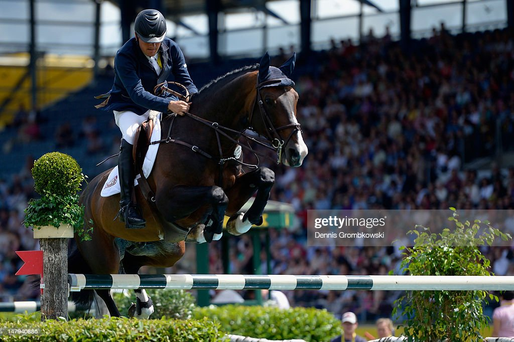Marc Bettinger of Germany and his horse Quannan-R compete in the RWE Prize of North-Rhine-Westphalia jumping competition during day four of the 2012 CHIO Aachen tournament on July 6, 2012 in Aachen, Germany.