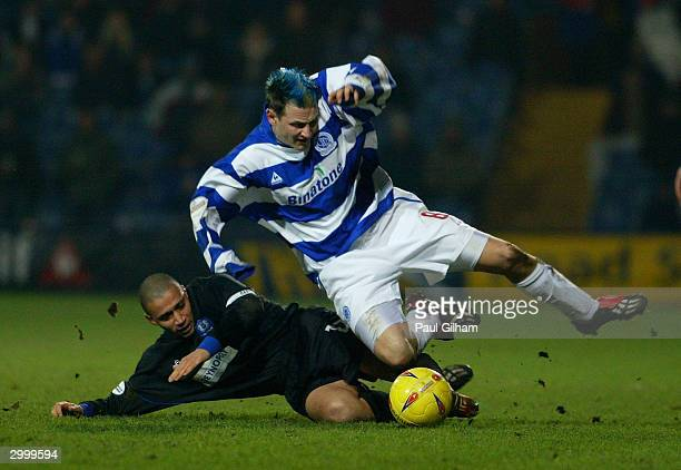 Marc Bircham of Queens Park Rangers is tackled by Curtis Woodhouse of Peterborough United during the Nationwide Second Division match between Queens...