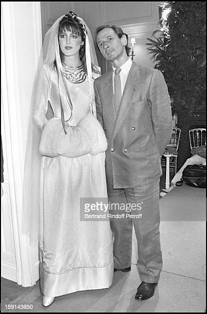 Marc Bohan and a model attend the presentation of Christian Dior's Haute Couture Fall Winter 198182 fashion collection