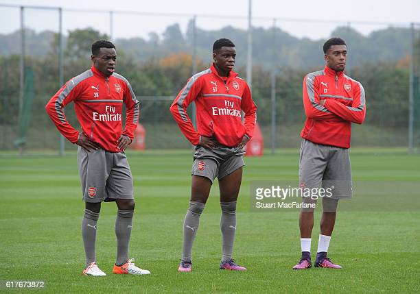 Marc Bola Stephy Mavididi and Alex Iwobi of Arsenal during a training session at London Colney on October 24 2016 in St Albans England