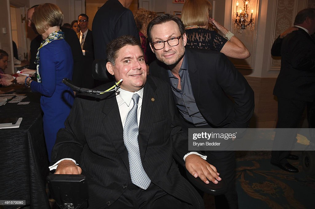 Marc Buoniconti and actor Christian Slater attend the 30th Annual Great Sports Legends Dinner to benefit The Buoniconti Fund to Cure Paralysis at The Waldorf Astoria on October 6, 2015 in New York City.