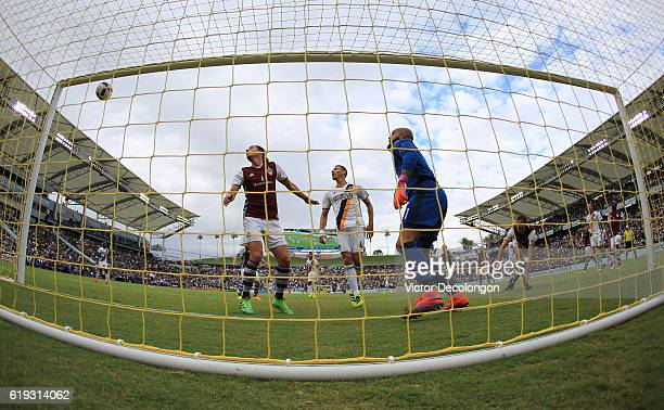 Marc Burch and goalkeeper Tim Howard of Colorado Rapids and Daniel Steres of Los Angeles Galaxy watch as the ball goes into the net for a goal on a...