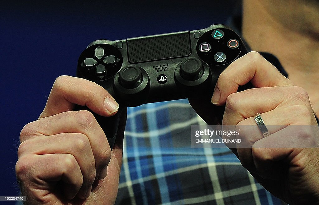 Marc Cerny, lead architect of PlaySation 4, introduces the BioShock4, the new controller for Sony's PlayStation 4 at a news conference February 20, 2013 in New York. AFP PHOTO/EMMANUEL DUNAND