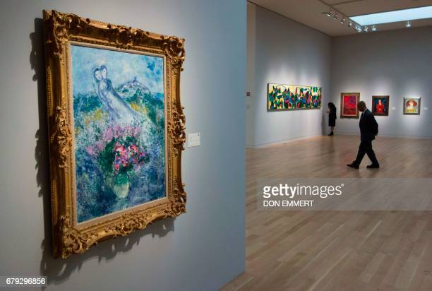 Marc Chagall's 'Les Fleurs de Vence' is displayed during a media preview May 5 2017 at Sotheby's In New York The piece is one of the creations to be...