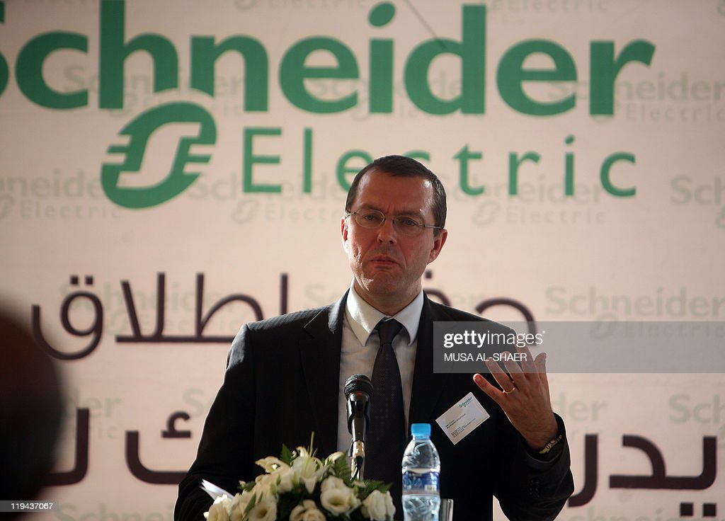 Marc Coroler, vice president of the Schneider Electric company for Central Europe, speaks to the press during the innauguration of the French group Schneider Electric, a global specialist in energy management, which opened its offices on July 20, 2011, in the French-Palestinian industrial zone in the city of Bethlehem in the Israeli occupied West Bank.AFP PHOTO/MUSA AL-SHAER .