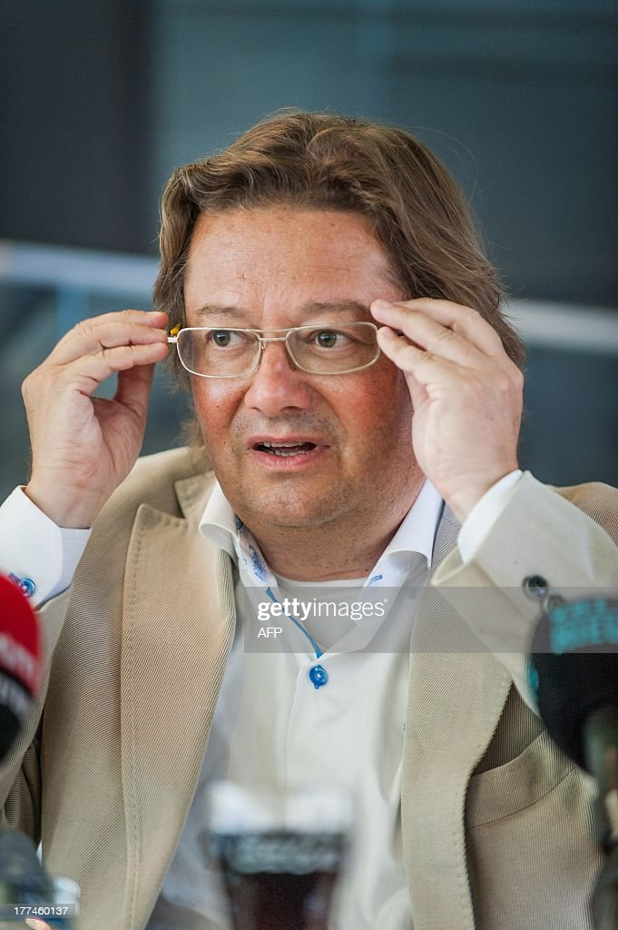 Marc Coucke speaks during a press conference and presentation of the new main shareholder of the Belgian first league soccer team KV Oostende, on August 23, 2013. Belgian businessman Marc Coucke who owns the Omega Pharma cycling team is now the majority shareholder of KV Oostende with 60 percent of the stocks.