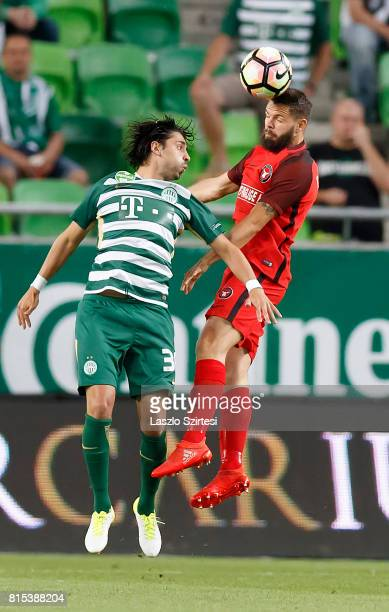 Marc Dal Hende of FC Midtjylland wins the ball in the air from Rui Pedro of Ferencvarosi TC during the UEFA Europa League Second Qualifying Round 1st...