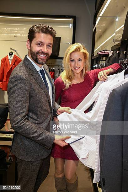Marc Demmig and Nina Ensmann attend the Hugo Boss Store Event on April 25 2016 in Duesseldorf Germany
