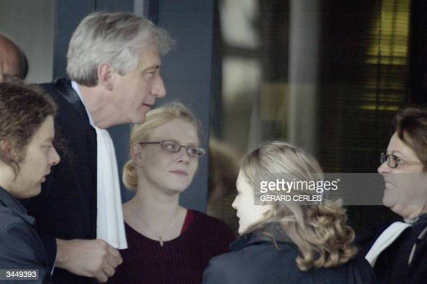 Marc Dutroux's victims Laetitia Delhez and Sabine Dardenne talk with their lawyers George Henry Bauthier Celine Parisse and with Belgian cartoonist...