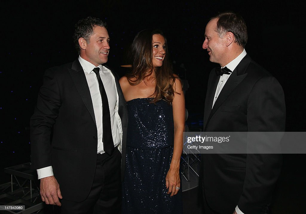 Marc Ellis (L) and his wife Agustina talk with New Zealand Prime Minister John Key during the launch of the New Zealand Olympic Team uniform at the Prime Minister's Olympic Gala Dinner at the Viaduct Events centre on June 28, 2012 in Auckland, New Zealand.