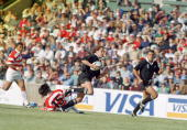 Marc Ellis escapes Tsutomu Matsuda during the pool stage game between Japan and New Zealand at the 1995 Rugby World Cup Free State Stadium...
