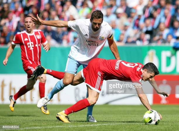 Marc Endres of Chemnitz and Robert Lewandowski of Bayern Muenchen battle for the ball during the DFB Cup first round match between Chemnitzer FC and...