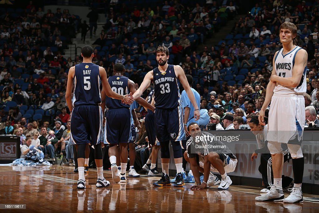Marc Gasol #33 and Austin Daye #5 of the Memphis Grizzlies congratulate each other during the game between the Memphis Grizzlies and the Minnesota Timberwolves on March 30, 2013 at Target Center in Minneapolis, Minnesota.