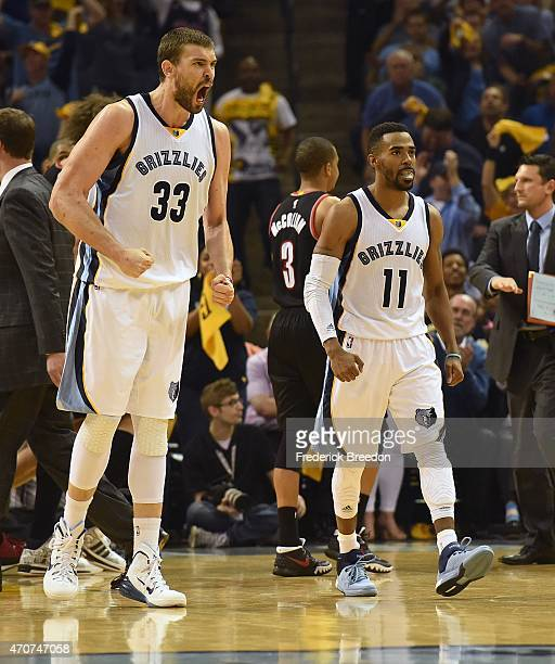 Marc Gasol and Mike Conley of the Memphis Grizzlies react to the croud during a timeout against the Portland Trailblazers during the first quarter of...