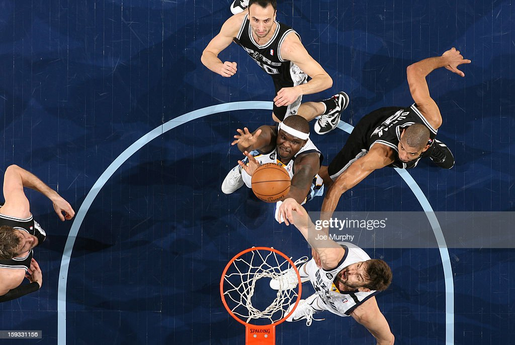 Marc Gasol #33 and Zach Randolph #50 of the Memphis Grizzlies battle for a rebound against Tim Duncan #21 and Manu Ginobili #20 of the San Antonio Spurs on January 11, 2013 at FedExForum in Memphis, Tennessee.