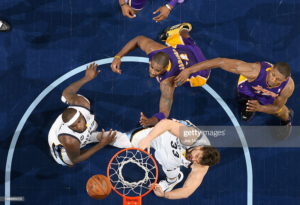 Marc Gasol #33 and Zach Randolph #50 of the Memphis Grizzlies rebound against Antawn Jamison #4 and Metta World Peace #15 of the Los Angeles Lakers on November 23, 2012 at FedExForum in Memphis, Tennessee.