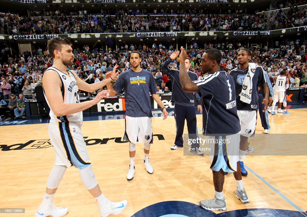 Marc Gasol #33, Austin Daye #5, and Tony Wroten #1 of the Memphis Grizzlies celebrate during the game against the San Antonio Spurs on April 1, 2013 at FedExForum in Memphis, Tennessee.