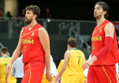 Marc Gasol of Spain and brother and team mate Pau Gasol of Spain walk to the bench together in the Men's Basketball Preliminary Round match between...