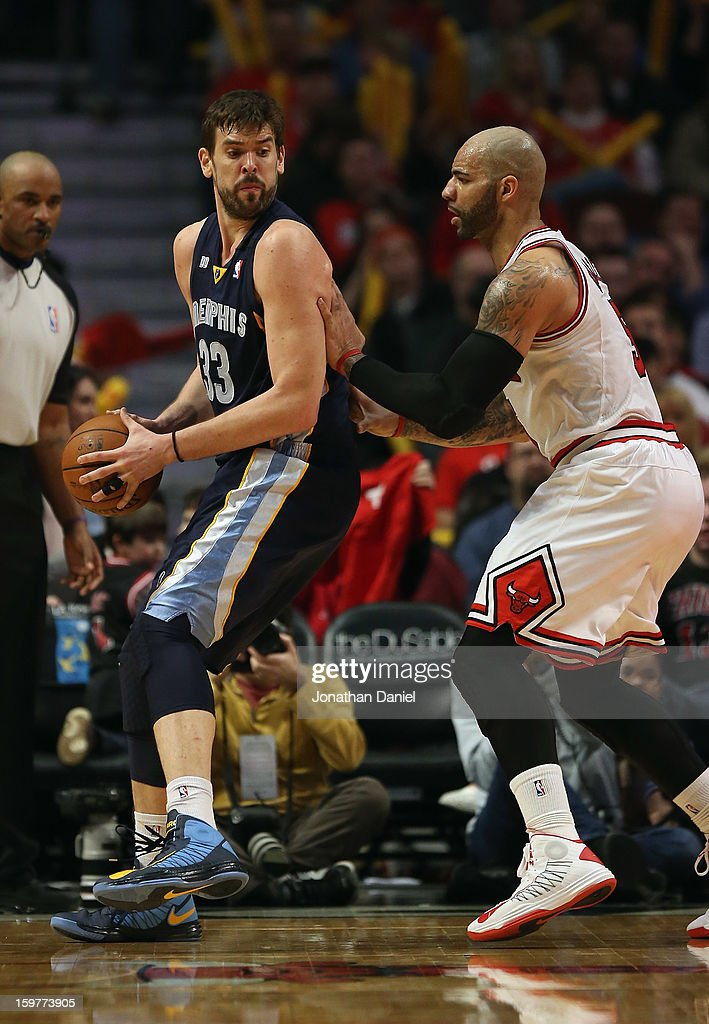 Marc Gasol #33 of the Memphis Grizzles moves against Carlos Boozer #5 of the Chicago Bulls at the United Center on January 19, 2013 in Chicago, Illinois. The Grizzlies defeated the Bulls 85-82 in overtime.
