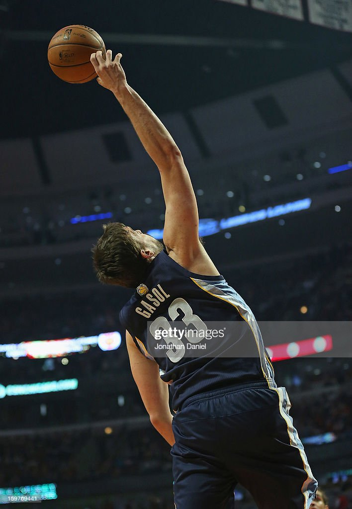 Marc Gasol #33 of the Memphis Grizzles reaches for the ball against the Chicago Bulls at the United Center on January 19, 2013 in Chicago, Illinois. The Grizzlies defeated the Bulls 85-82 in overtime.