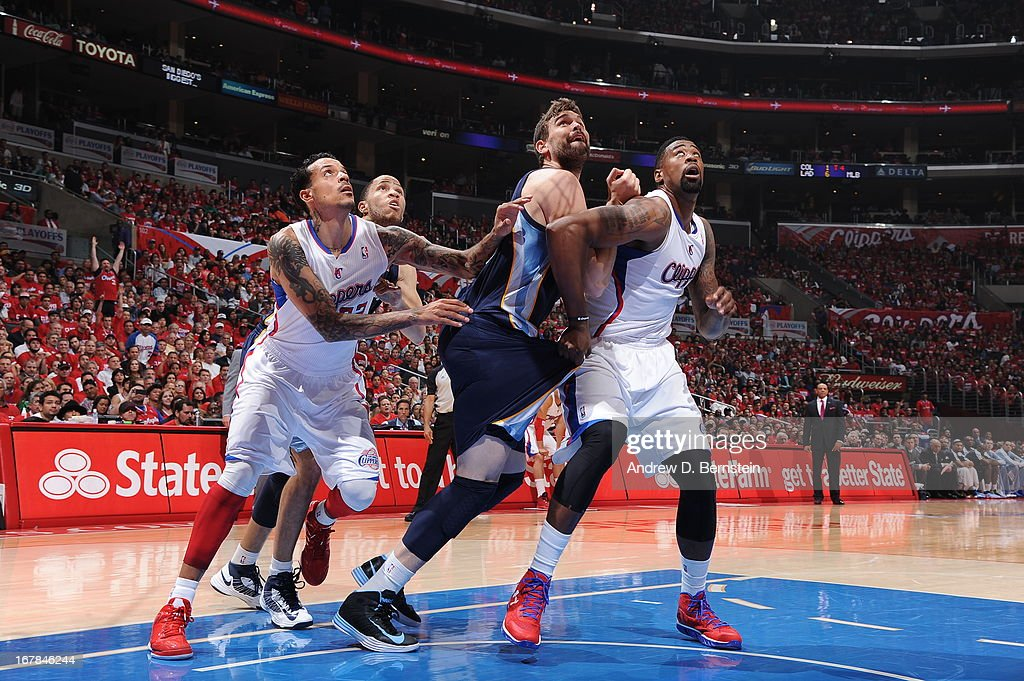 Marc Gasol #33 of the Memphis Grizzlies and DeAndre Jordan #6 of the Los Angeles Clippers battle for a rebound at Staples Center in Game Five of the Western Conference Quarterfinals during the 2013 NBA Playoffs on April 30, 2013 in Los Angeles, California.
