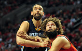 Marc Gasol of the Memphis Grizzlies and Robin Lopez of the Portland Trail Blazers battle for position under the basket during the second quarter in...