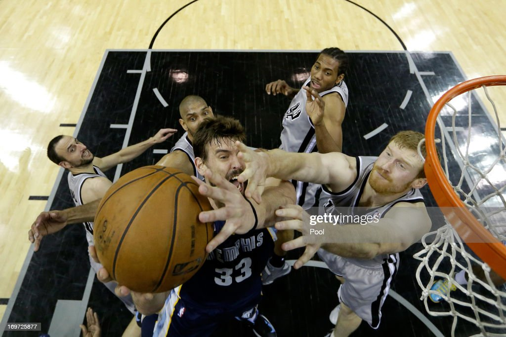 <a gi-track='captionPersonalityLinkClicked' href=/galleries/search?phrase=Marc+Gasol&family=editorial&specificpeople=661205 ng-click='$event.stopPropagation()'>Marc Gasol</a> #33 of the Memphis Grizzlies attempts a shot againsty <a gi-track='captionPersonalityLinkClicked' href=/galleries/search?phrase=Matt+Bonner&family=editorial&specificpeople=203054 ng-click='$event.stopPropagation()'>Matt Bonner</a> #15 of the San Antonio Spurs during Game One of the Western Conference Finals of the 2013 NBA Playoffs at AT&T Center on May 19, 2013 in San Antonio, Texas.