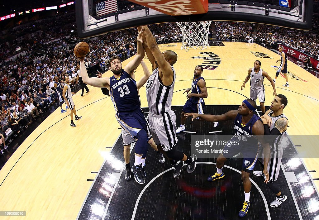 <a gi-track='captionPersonalityLinkClicked' href=/galleries/search?phrase=Marc+Gasol&family=editorial&specificpeople=661205 ng-click='$event.stopPropagation()'>Marc Gasol</a> #33 of the Memphis Grizzlies attempts a shot in the first half against <a gi-track='captionPersonalityLinkClicked' href=/galleries/search?phrase=Tim+Duncan&family=editorial&specificpeople=201467 ng-click='$event.stopPropagation()'>Tim Duncan</a> #21 of the San Antonio Spurs during Game One of the Western Conference Finals of the 2013 NBA Playoffs at AT&T Center on May 19, 2013 in San Antonio, Texas.