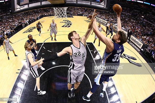 Marc Gasol of the Memphis Grizzlies attempts a shot in the first half against Tiago Splitter of the San Antonio Spurs during Game Two of the Western...