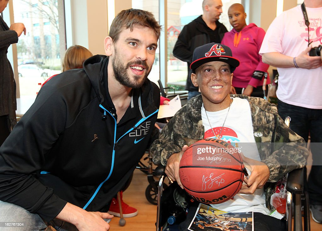 Marc Gasol #33 of the Memphis Grizzlies autographs a ball for a fan on February 25, 2013 at St. Jude Children's Research Hospital in Memphis, Tennessee.