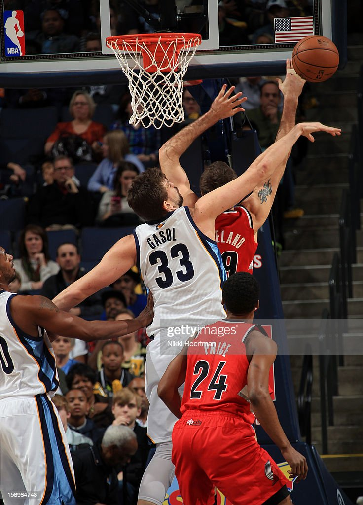 Marc Gasol #33 of the Memphis Grizzlies blocks a shot attempted by Joel Freeland #19 of the Portland Trail Blazers on January 4, 2013 at FedExForum in Memphis, Tennessee.