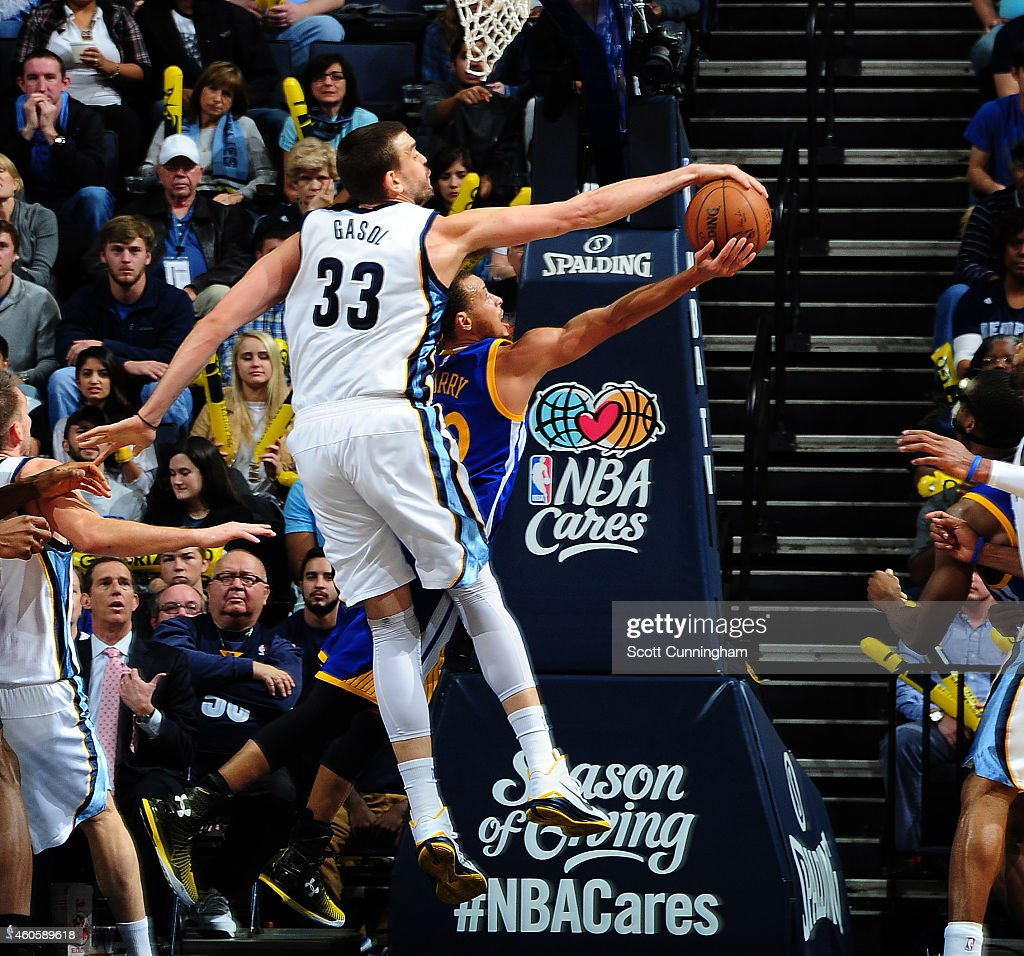 <a gi-track='captionPersonalityLinkClicked' href=/galleries/search?phrase=Marc+Gasol&family=editorial&specificpeople=661205 ng-click='$event.stopPropagation()'>Marc Gasol</a> #33 of the Memphis Grizzlies blocks a shot by <a gi-track='captionPersonalityLinkClicked' href=/galleries/search?phrase=Stephen+Curry+-+Basketball+Player&family=editorial&specificpeople=5040623 ng-click='$event.stopPropagation()'>Stephen Curry</a> #30 of the Golden State Warriors on December 16, 2014 at the FedEx Forum in Memphis, Tennessee.