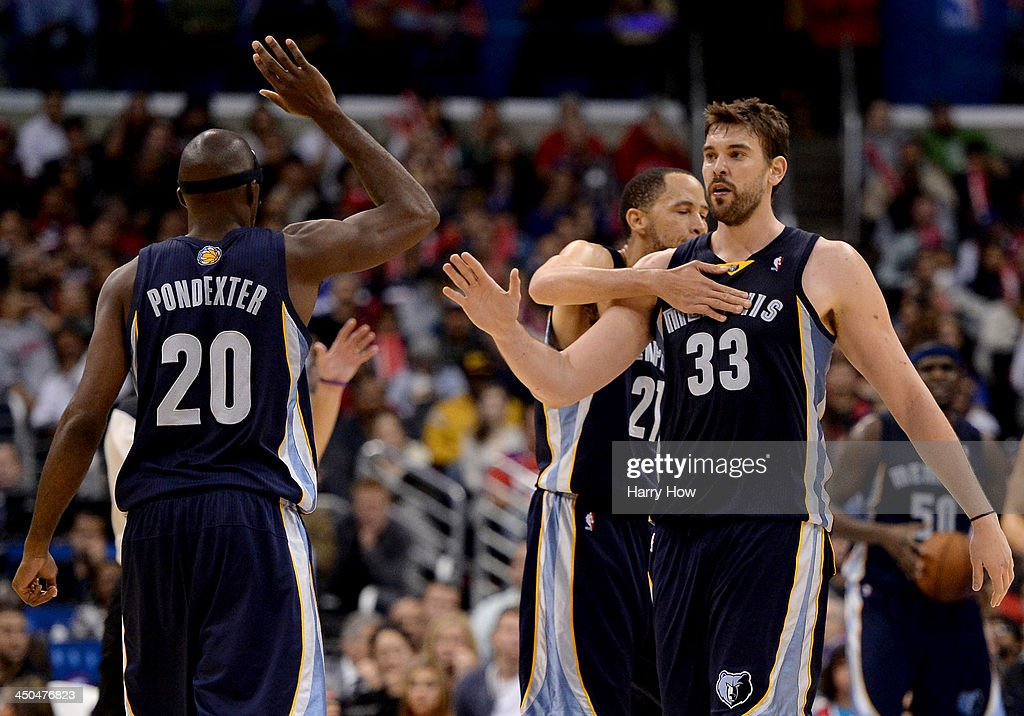 Marc Gasol #33 of the Memphis Grizzlies celebrates his score and foul with Tayshaun Prince #21 and Quincy Pondexter #20 on way to a 106-102 win over the Los Angeles Clippers at Staples Center on November 18, 2013 in Los Angeles, California.