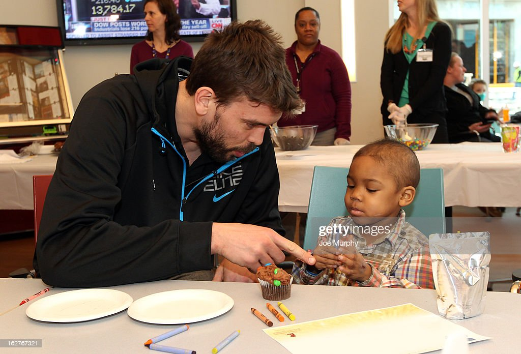 Marc Gasol #33 of the Memphis Grizzlies colors with children on February 25, 2013 at St. Jude Children's Research Hospital in Memphis, Tennessee.
